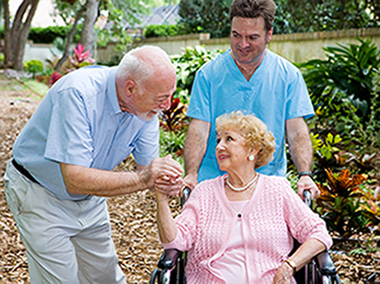 Male caregiver and couple holding hands